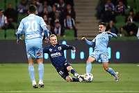 22nd May 2021, Melbourne, Australia;  Nathaniel Atkinson of Melbourne City slides in on Jack Clisby of Central Coast Mariners during the Hyundai A-League football match between Melbourne City FC and Central Coast Mariners at AAMI Park in Melbourne, Australia.