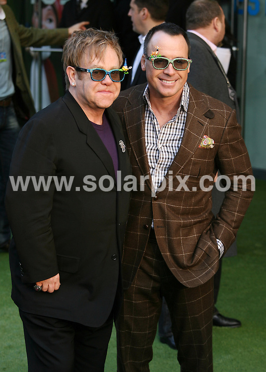 **ALL ROUND PICTURES FROM SOLARPIX.COM**                                             **WORLDWIDE SYNDICATION RIGHTS**                                                                                  Caption: UK film premiere of Gnomeo and Juliet at Odeon Leicester Square  in London Uk                                                                              This pic:  Executive Producer Sir Elton John and Producer David Furnish                                                                                            JOB REF: 12730       LNJ       DATE:  30.01.2011                                                          **MUST CREDIT SOLARPIX.COM OR DOUBLE FEE WILL BE CHARGED**                                                                      **MUST AGREE FEE BEFORE ONLINE USAGE**                               **CALL US ON: +34 952 811 768 or LOW RATE FROM UK 0844 617 7637**