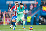 Lionel Andres Messi (r) of FC Barcelona battles for the ball with Saul Niguez Esclapez of Atletico de Madrid during their La Liga match between Atletico de Madrid and FC Barcelona at the Santiago Bernabeu Stadium on 26 February 2017 in Madrid, Spain. Photo by Diego Gonzalez Souto / Power Sport Images