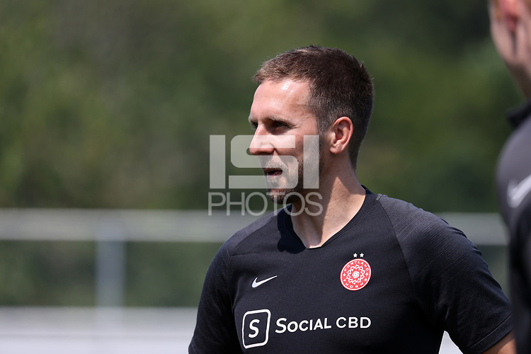 CARY, NC - SEPTEMBER 12: Assistant coach Rich Gunney of the Portland Thorns FC before a game between Portland Thorns FC and North Carolina Courage at Sahlen's Stadium at WakeMed Soccer Park on September 12, 2021 in Cary, North Carolina.