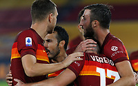 Roma s Jordan Veretout, second from right, celebrates with his teammate Bryan Cristante after scoring on a penalty kick during the Serie A soccer match between Roma and Benevento at Rome's Olympic Stadium, October 18, 2020.<br /> UPDATE IMAGES PRESS/Riccardo De Luca
