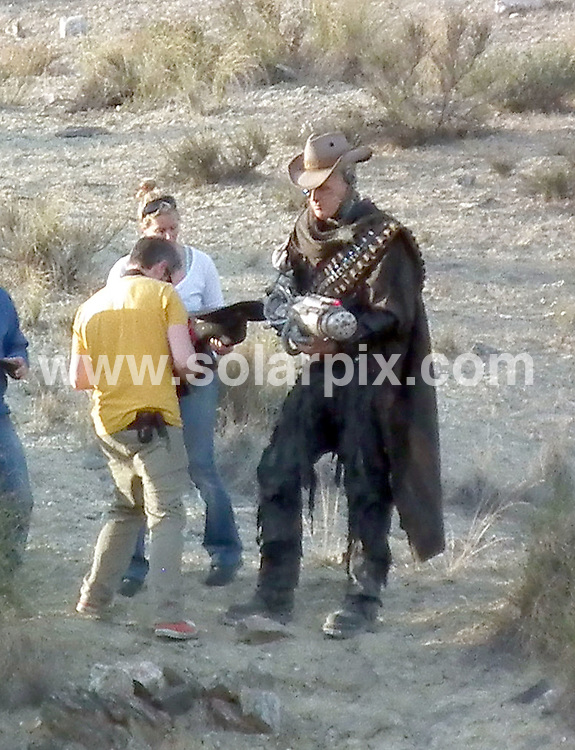 """**ALL ROUND EXCLUSIVE PICTURES FROM SOLARPIX.COM**.**WORLDWIDE SYNDICATION RIGHTS**                                                                               Caption:  Karen Gillan who plays Dr Who's played by Matt smith's companion Amy Pond on the set filming the new Doctor who series """"Gun slingers"""" in Spain. .Karen strolled around between takes on the Western film set playing ball games with a friend who looks very similar to Matt Smith..Karen has just split from her long term partner so could this be the beginning of a new romance.The series will include half robot & half human cowboys fighting with the doctor and his pretty assistant. . This pic: Robot on set                                                                                          JOB REF: 14546       RAP       DATE: 09.03.2012                                                           **MUST CREDIT SOLARPIX.COM OR DOUBLE FEE WILL BE CHARGED**                                                                      **MUST AGREE FEE BEFORE ONLINE USAGE**                               **CALL US ON: +34 952 811 768 or LOW RATE FROM UK 0844 617 7637**"""