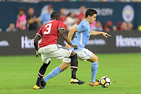 Houston, TX - Thursday July 20, 2017: Eric Bailly and Samir Nasri during a match between Manchester United and Manchester City in the 2017 International Champions Cup at NRG Stadium.