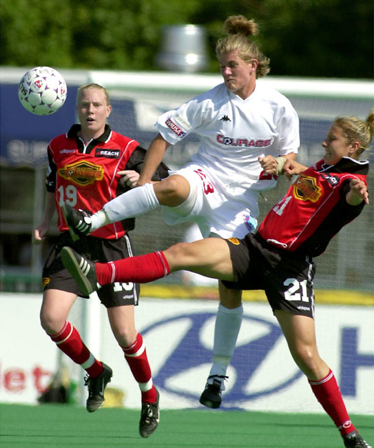 Carolina Courage defenseman Erin Baxter (23) kicks the ball from Philadelphia Charge midfielder Laurie Schwoy (21) in the first half of play in a Women's United Soccer Association game Sunday June 10, 2001 in Villanova PA. Philadelpha Charge  midfielder Rebekah McDowell (19) looks on. (AP Photo/Brad C Bower)