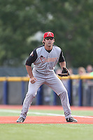 Scott Price (9) of the Salem-Keizer Volcanoes in the field at first base during a game against the Hillsboro Hops at Ron Tonkin Field on July 26, 2015 in Hillsboro, Oregon. Hillsboro defeated Salem-Keizer, 4-3. (Larry Goren/Four Seam Images)