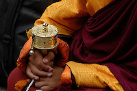 Images from the Book Journey Through Colour and Time, a novice Monk holding the traditional prayer wheel,Lhasa,Tibet