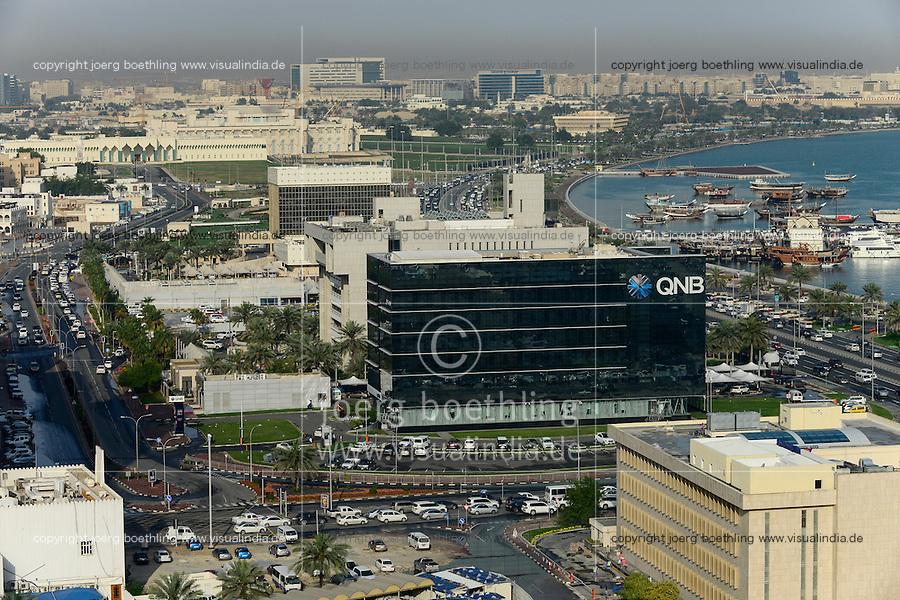 QATAR, Doha, downtown, view to  QNB QATAR National Bank, parliament and dhow harbour / KATAR, Doha, Blick zum Parlament und Bucht mit Dhau Hafen