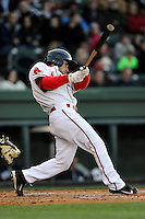 Third baseman Carlos Asuaje (20) of the Greenville Drive bats in a game against the Charleston RiverDogs on Wednesday, April 16, 2014, at Fluor Field at the West End in Greenville, South Carolina. Charleston won, 8-7. (Tom Priddy/Four Seam Images)