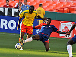 08 July 09: Grenada's Shane Rennie (25) and Haiti's Brunel Fucien (7) fight for the ball during their match at the CONCACAF Gold Cup at RFK Stadium in Washington, DC.