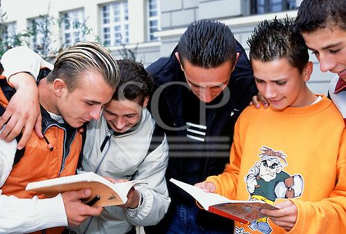 Sarajevo, Bosnia. Students looking at textbooks outside the university.