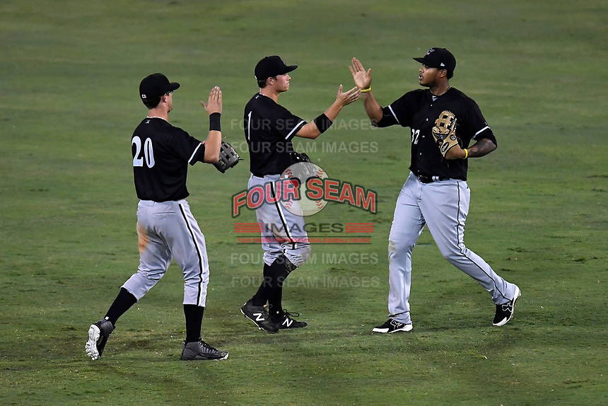 Outfielders Blake Rutherford (20), Alex Call (1) and Willy Garcia (32) of the Kannapolis Intimidators celebrate after recording the final out in Game 3 of the South Atlantic League Championship series against the Greenville Drive on Thursday, September 14, 2017, at Fluor Field at the West End in Greenville, South Carolina. Kannapolis won, 5-4. Greenville leads the series 2-1. (Tom Priddy/Four Seam Images)