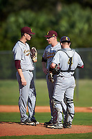 Central Michigan Chippewas pitching coach Jeff Opalewski (26) talks with relief pitcher Zach Kohn (49) and catcher Blake Cleveland (4) during a game against the Boston College Eagles on March 3, 2017 at North Charlotte Regional Park in Port Charlotte, Florida.  Boston College defeated Central Michigan 5-4.  (Mike Janes/Four Seam Images)