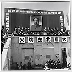 """A rally at Red Guard Square (the renamed People's Stadium) calls for the """"burning of the Northeastern Bureau"""" (large characters in center); banners read: (top) """"We swear to carry out the great Proletarian Cultural Revolution to the end""""; (left) """"We will die to protect the Communist Party Central Committee"""" and (right) """"We will die to protect Chairman Mao""""; Harbin, Heilongjiang Province, August 17, 1966"""