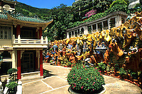 The quiet and beauty of Tiger Balm Gardens in Hong Kong Island in todays modern business climate with the colorful carvings out of the mountain