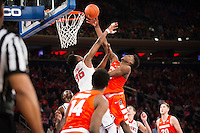 NEW YORK, NY - Sunday December 13, 2015: Malachi Richardson (#23) of Syracuse fights hard for a basket against Yankuba Sima (#35) of St. John's as the two square off during the NCAA men's basketball regular season at Madison Square Garden in New York City.