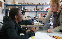 Hearing impaired student talking with a Learning Support Assistant, Art & Design, Kingston College.