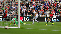Pictured: Gylfi SIgurdsson of Swansea (C) shows his frustration after his shot scraped off the post Sunday 30 August 2015<br /> Re: Premier League, Swansea v Manchester United at the Liberty Stadium, Swansea, UK