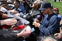 February 25, 2010:  Third Baseman Alex Rodriguez of the New York Yankees signs autographs after practice at Legends Field in Tampa, FL.  Photo By Mike Janes/Four Seam Images