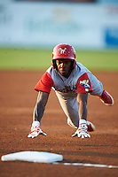 Williamsport Crosscutters shortstop Roman Quinn #4 slides head first into third during a NY-Penn League game against the Batavia Muckdogs at Dwyer Stadium on August 25, 2012 in Batavia, New York.  Batavia defeated Williamsport 6-5.  (Mike Janes/Four Seam Images)