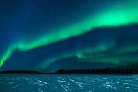 The Aurora Borealis over Chena Lake in North Pole, Alaska.