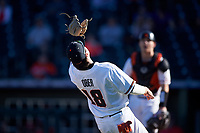 Oregon State Beavers third baseman Ryan Ober (18) catches a pop fly in foul territory during an NCAA game against the New Mexico Lobos at Surprise Stadium on February 14, 2020 in Surprise, Arizona. (Zachary Lucy / Four Seam Images)