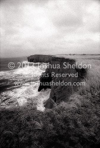 Waves crashing on eroded cliffs<br />