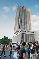 Hong Kong, Government Offices, 1 October 2014<br /> <br /> Students and other supporters of the Occupy Central movement congregating around the government offices area at Tamar. All the roads in the area are blocked from traffic and public transport.<br /> In front of the Central HQ of the Peoples Liberation Army in Central, which shows the Chinese national flag.<br /> <br /> Photo Kees Metselaar