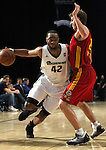 Marcus Landry of the Reno Bighorns drives past Fort Wayne Mad Ants defender Ryan Wittman in Friday night's minor league basketball game, Feb. 11, 2011, at the Reno Events Center in Reno, Nev. .Photo by Cathleen Allison