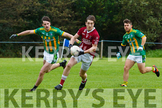 Darren Houlihan Cromane and CAthal O'Sé Lispole in action during the Kerry Novice club semi final in Keel on Sunday