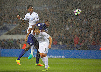 Pictured: Leroy Fer of Swansea City scores a goal on top of Wes Morgan of Leicester City and team mate Fernando Llorente Saturday 27 August 2016<br />