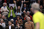 Fans waves for a ball from USA's John McEnroe during the HSBC Tennis Cup series at First Niagara Center in Buffalo, NY on October 22, 2011