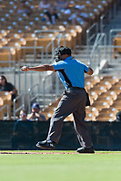 Home plate umpire Jeremie Rehak calls a batter out on strikes during an Arizona Fall League game between the Mesa Solar Sox and the Glendale Desert Dogs at Camelback Ranch on October 15, 2018 in Glendale, Arizona. Mesa defeated Glendale 8-0. (Zachary Lucy/Four Seam Images)