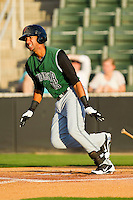 Jose Cuevas #15 of the Augusta GreenJackets follows through on his swing against the Kannapolis Intimidators at CMC-Northeast Stadium on May 2, 2012 in Kannapolis, North Carolina.  The GreenJackets defeated the Intimidators 9-6.  (Brian Westerholt/Four Seam Images)