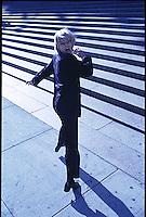 Terrorized fleeing woman towards steps in background<br />