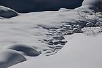 A snow covered rocky stream in Colorado.