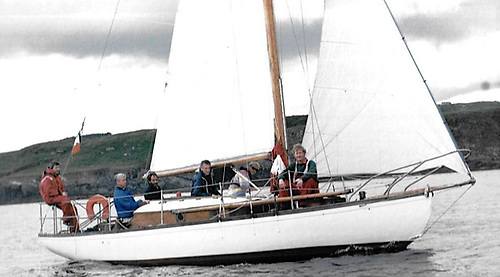 The MAB at the Glandore Classics 1996. Owner and Skipper the late Guy Perrem sitting at the mast. Ron Holland in the cockpit helming, Tom MacSweeney on the stern