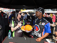 Mar. 16, 2013; Gainesville, FL, USA; NHRA top fuel dragster driver Antron Brown (right) and funny car driver Alexis DeJoria during qualifying for the Gatornationals at Auto-Plus Raceway at Gainesville. Mandatory Credit: Mark J. Rebilas-