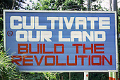 GRENADA 1982<br /> Cultivate Our Land, Build the Revolution.  Roadside hoarding erected by the People's Revolutionary Government, led by Prime Minister Maurice Bishop.