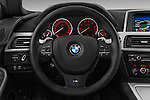 Steering wheel view of a 2012 Bmw SERIES 6 Gran Coupe 640i 4 Door Sedan 2WD