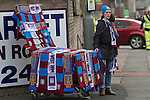 Burnley 1 West Ham United 3, 18/10/2014. Turf Moor, Premier League. A souvenir seller with scarves outside The fixture was won by the visitors by three goals to one watched by 18,936 spectators. The defeat meant that Burnley still had not won a league match since being promoted from the Championship the previous season. Photo by Colin McPherson.
