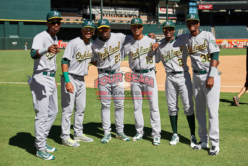 Oakland Athletics George Bell (6), Yerdel Vargas (20), Lazaro Armenteros (23), Christopher Quintin (13), Marcos Brito (2), Kevin Richards (38) pose for a photo before an Instructional League game against the Arizona Diamondbacks on October 15, 2016 at Chase Field in Phoenix, Arizona.  (Mike Janes/Four Seam Images)