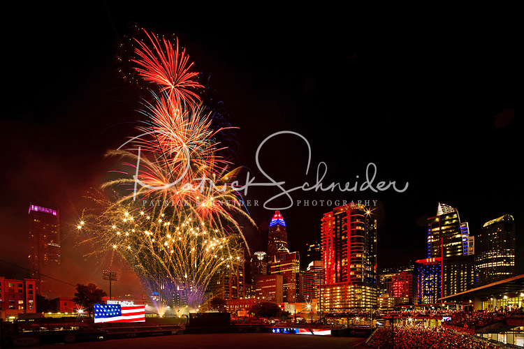 Fireworks from Skyshow Charlotte  2017 explode over BB&T Ballpark against the backdrop of the Charlotte NC skyline as the city celebrated the July 4th holiday in 2017. Photographer has fireworks celebrations in Charlotte from multiple years. The collection of Charlotte NC fireworks photos show different perspectives and weather conditions.<br /> <br /> Charlotte Photographer - PatrickSchneiderPhoto.com