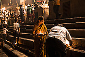 Pilgrims get ready to worship the river Ganges at the Dashashwamedh Ghat in the ancient city of Varanasi in Uttar Pradesh, India. Photograph: Sanjit Das/Panos