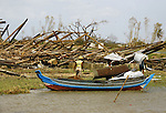 Cyclone Nargis survivors  salvage material at the village of Kamingo, in Irrawaddy Division, May 10, 2008. Despairing survivors in Myanmar awaited emergency relief on Friday, a week after 100,000 people were feared killed as the cyclone roared across the farms and villages of the low-lying Irrawaddy delta region. The storm is the most devastating one to hit Asia since 1991, when 143,000 people were killed in neighboring Bangladesh. Photo by Eyal Warshavsky  *** Local Caption *** ëì äæëåéåú ùîåøåú ìàéì åøùáñ÷é àéï ìòùåú áúîåðåú ùéîåù ììà àéùåø