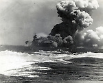 September 15, 1942 : Solomon Islands - USS Wasp are on fire shortly after being torpedoed by Japanese submarine I-19 in September 15, 1942, Solomon Islands. She participated the naval Battle of the Eastern Solomons (also called The Battle of the Stewart Islands or The Second Battle of the Solomon Sea) in August 23-24, 1942, which was the third carrier battle of the Pacific campaign of World War II and the second major engagement fought between the United States Navy and the Imperial Japanese Navy during the Guadalcanal Campaign. (Photo by Kingendai Photo Library/AFLO)