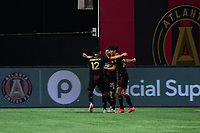 ATLANTA, GA - APRIL 24: Atlanta United midfielder #20 Emerson Hyndman celebrates his goal in the 85th minute with midfielder #22 Jurgen Damm and defender #12 Miles Robinson during a game between Chicago Fire FC and Atlanta United FC at Mercedes-Benz Stadium on April 24, 2021 in Atlanta, Georgia.
