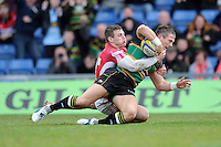 Tom May of Northampton Saints scores a try in both corners despite the attention of Nick Scott of London Welsh during the Aviva Premiership match between London Welsh and Northampton Saints at the Kassam Stadium on Sunday 14th April 2013 (Photo by Rob Munro)