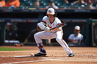 Trey Ochoa (9) of the Sam Houston State Bearkats lays down a bunt against the Vanderbilt Commodores in game one of the 2018 Shriners Hospitals for Children College Classic at Minute Maid Park on March 2, 2018 in Houston, Texas. The Bearkats walked-off the Commodores 7-6 in 10 innings.   (Brian Westerholt/Four Seam Images)