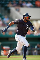 Detroit Tigers shortstop Willi Castro (49) runs to first base during a Grapefruit League Spring Training game against the Atlanta Braves on March 2, 2019 at Publix Field at Joker Marchant Stadium in Lakeland, Florida.  Tigers defeated the Braves 7-4.  (Mike Janes/Four Seam Images)
