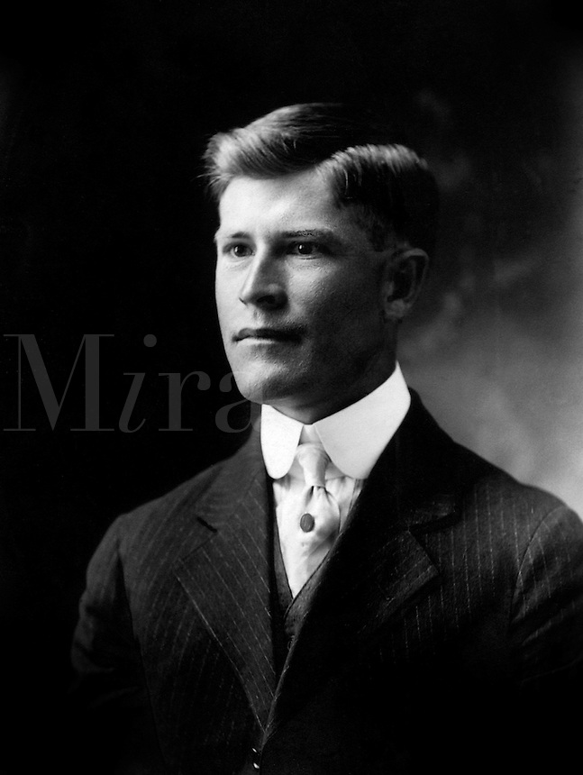 Well-dressed young man in rural Texas poses for his portrait in early 1930's. Charles Holman. Marble Falls, Texas.